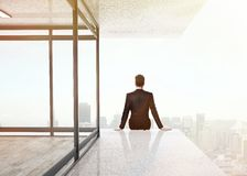 Man sitting on skyscrapper Royalty Free Stock Photo