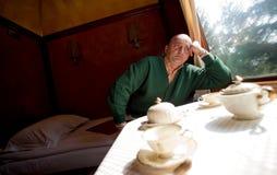 Man sitting sleeping wagon in train Royalty Free Stock Images