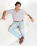Man sitting on a sofa Stock Photo