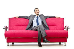 Man sitting in the sofa Stock Photos
