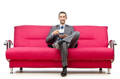 Man sitting in the sofa Stock Images