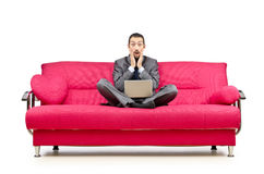 Man sitting in the sofa Stock Photography