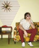 Man sitting on sofa. Stock Photography