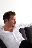 Man sitting in sofa Stock Photos