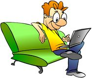 Man sitting on sofa with laptop Royalty Free Stock Photography