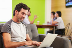 Man Sitting On Sofa And Working In Design Studio Royalty Free Stock Photos