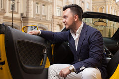 Man sitting in sport car Stock Images