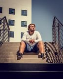Man Sitting On Stairs royalty free stock photos