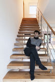 Man sitting on the stairs Stock Photography