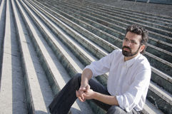 Man sitting in stairs stock image