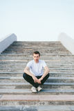 Man sitting on stairs outside Stock Image