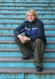 Man sitting on steps Royalty Free Stock Image