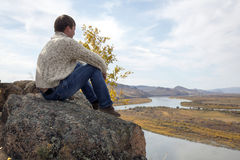 Man sitting on the stone Stock Photo