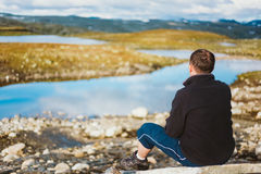 Man Sitting On Stone In Norwegian Mountains Royalty Free Stock Photos