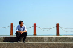 man sitting on the stone stairs Stock Image