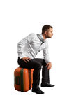 Man sitting on the suitcase Royalty Free Stock Photo