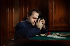 Man sitting at the table crying. Royalty Free Stock Photography