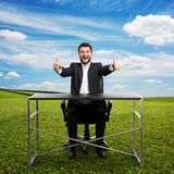 Man sitting at the table Stock Images
