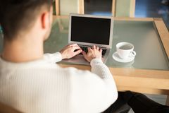 Man sitting at table at home working royalty free stock images
