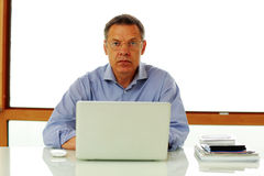 Man sitting on the table with laptop computer Stock Images