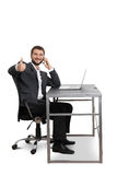 Man sitting at the table with laptop Royalty Free Stock Photo