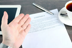 Man sitting in a table showing, offering  a contract and where t Stock Photo