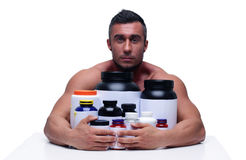 Man sitting at the table with sports nutrition Stock Photo