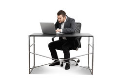 Man sitting at the table and using laptop Royalty Free Stock Photos