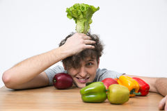 Man sitting at the table with vegetables Stock Photo