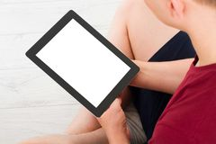 Man sitting with tablet in hands. Online shopping.Top view.Mock up.Copy space.Template.Blank. stock photos