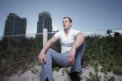 Man sitting on teh beach Stock Photo
