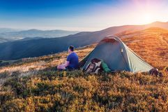 Man, tent, mountains Royalty Free Stock Photography