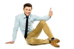 Man sitting with thumbs up Royalty Free Stock Photos