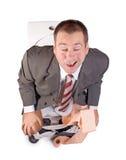 Man sitting on the toilet Stock Photo