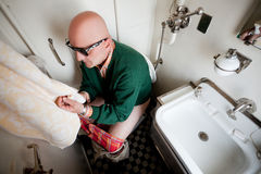 Man sitting on a toilet in train Stock Photography