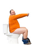 Man sitting on toilet with uplifted hands Royalty Free Stock Image