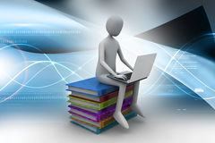 Man sitting on top of books while using laptop Stock Photo