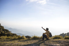 A man sitting on top of mountain. A man sitting on the top of mountain stock image