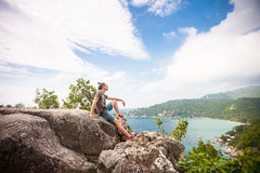 Man sitting on top of a mountain and enjoying view. Man sitting on top of a mountain and enjoying beautiful view royalty free stock photos