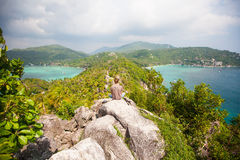 Man sitting on top of a mountain and enjoying view. Man sitting on top of a mountain and enjoying beautiful view royalty free stock photo