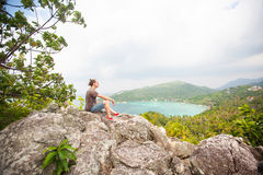 Man sitting on top of a mountain and enjoying view. Man sitting on top of a mountain and enjoying beautiful view stock photos