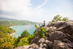 Man sitting on top of a mountain and enjoying view. Man sitting on top of a mountain and enjoying beautiful view royalty free stock photography