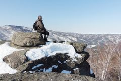 Man sitting at top of the mountain, Mountain Round, Altai, Russia. Man sitting at top of the mountain, Mountain Round, Belokurikha city, Altai, Russia stock images