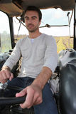 Man sitting in tractor Stock Photography