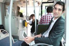 Man sitting on a tram Stock Image