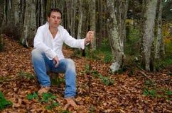 Man sitting on tree trunk Royalty Free Stock Photo