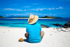 Man sitting on the tropical island beach