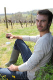 Man sitting in a vineyard Royalty Free Stock Images