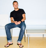 Man sitting in waiting room stock image