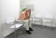 Man sitting in waititng room Stock Photography